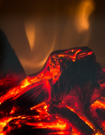 burning wood with flames of an artificial fireplace photo