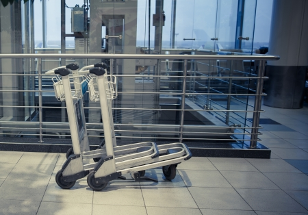 two trolleys in empty hall of airport in Moscow Domodedovo