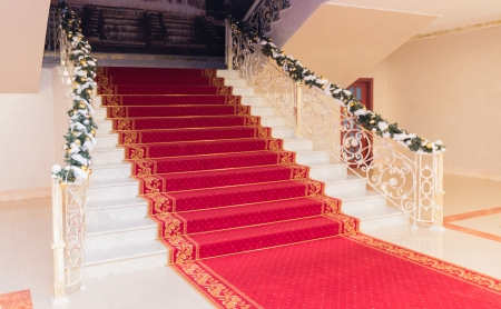 Classic red carpet on a marble staircase