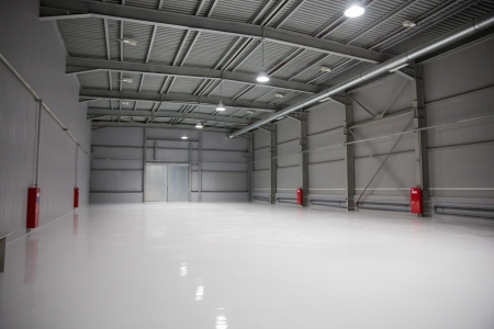 empty room of modern storehouse with gates