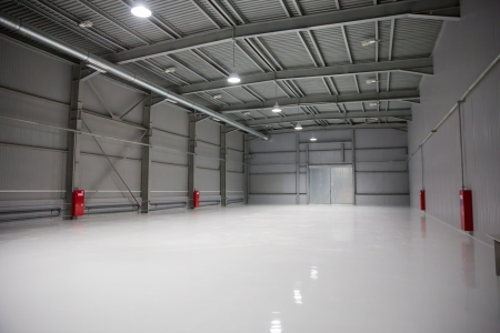 storage warehouse: empty room of modern storehouse with gates
