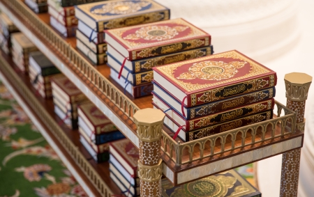 holy Quran books on a shelf in a mosque Stock Photo