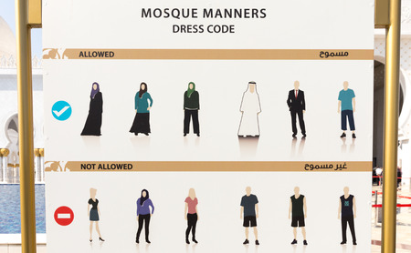 regulations: Dress code sign in Sheikh Zayed Grand Mosque in Abu Dhabi.