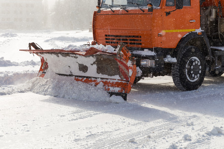 plows: Snowplow removing snow from city road