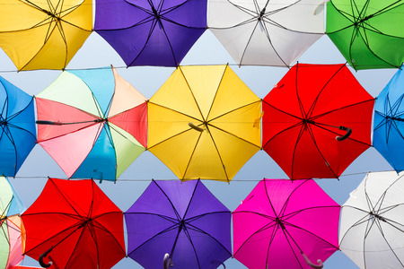 colorful umbrellas hanging on the sky background photo