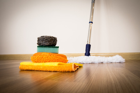 set of cleaning equipment on a wooden floor photo