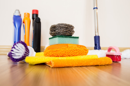 brooming: set of cleaning equipment on a wooden floor
