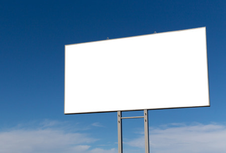 Big blank billboard on a roadside and blue sky