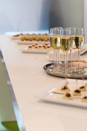 Glasses of sparkling champagne on a buffet table Stock Photo - 28712606