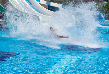 Colorful waterpark tubes and a swimming pool. Outdoor shot 写真素材