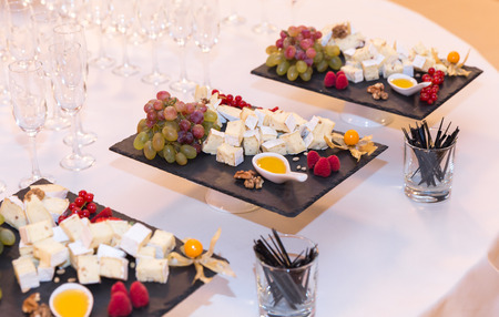 Buffet table with brie cheese and grapes photo