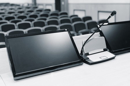 rostrum: Rostrum with microphone and computer in conference hall