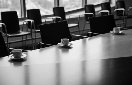 furniture concept: Meeting room with coffee cups before meeting