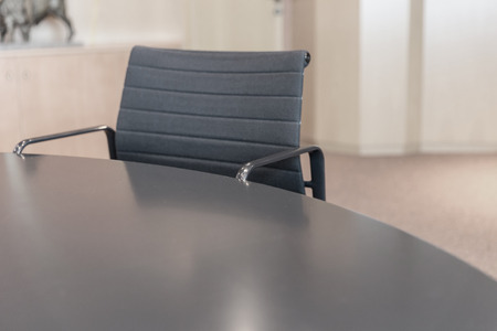 Table and armchair in a conference room photo