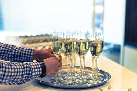 Glasses of sparkling champagne on a buffet table photo