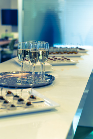 Glasses of sparkling champagne on a buffet table Stock Photo - 28716108