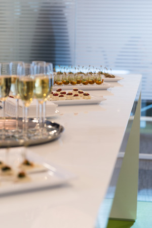 Glasses of sparkling champagne on a buffet table Stock Photo - 28716120