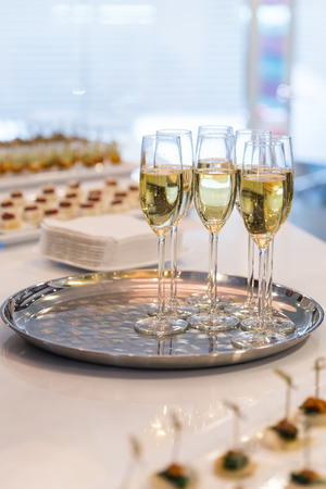 Glasses of sparkling champagne on a buffet table Stock Photo - 28716142