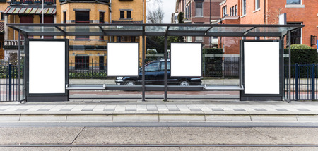 Blank billboard on a roadside in european town photo