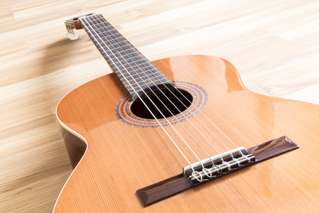 A classical guitar with six nylon strings