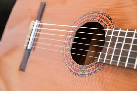 A classical guitar with six nylon strings photo