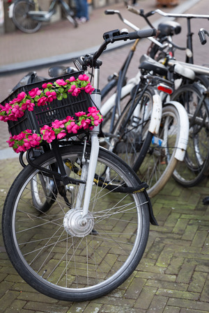 Bike locked for parking in european city photo