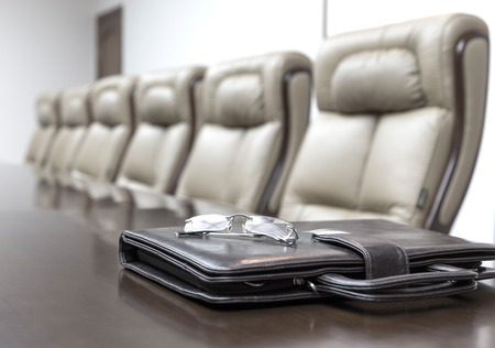 Closeup of  on table in empty corporate conference room before business meeting in office photo