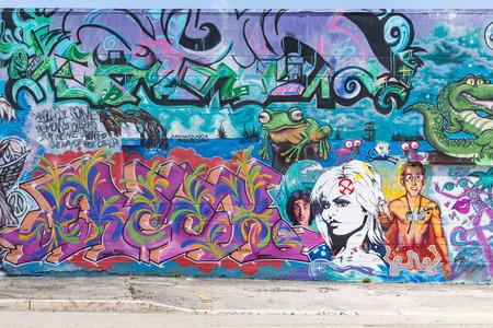 MIAMI, USA - AUGUST 29, 2014 : Graffiti on walls in graffiti district on August 29, 2014 in Miami.