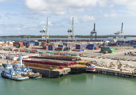 MIAMI, USA - SEPTEMBER 06, 2014 : The Port of Miami with containers and cranes on the background on September 06, 2014 in Miami.