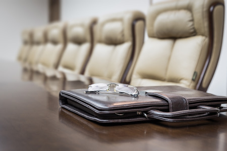 presentation board: Closeup of  on table in empty corporate conference room before business meeting in office