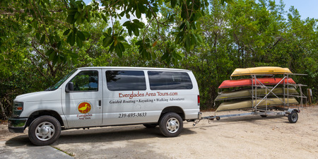 everglades: EVERGLADES, FLORIDA, USA - AUGUST 31: Minivan with four kayaks in trailer on August 31, 2014 in Everglades, Florida, USA. Editorial