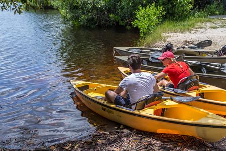 everglades: EVERGLADES, FLORIDA, USA - AUGUST 31: Tourists kayaking on August 31, 2014 in Everglades, Florida, USA.