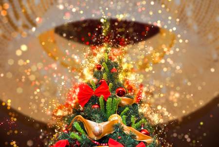 artificial lights: Tall christmas tree with round chandelier on a ceiling