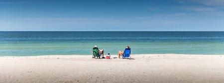 Happy Romantic Couple Enjoying Beautiful view at the Beach 写真素材
