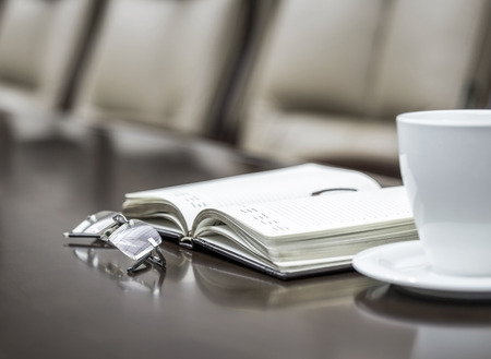 coffee meeting: Business papers in conference room before meeting in office