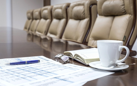 Business papers in conference room before meeting in office