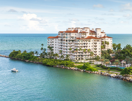 waterfront property: MIAMI, USA - SEPTEMBER 06, 2014 :View of apartments in Fisher Island on September 06, 2014 in Miami.
