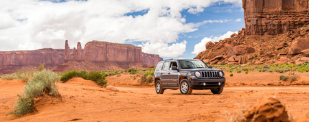 MONUMENT VALLEY, UTAH, USA - MAY 25, 2015 - Offroading through the Monument Valley in a Jeep Patriot. Jeep Patriot  is a four-wheel drive off-road and sport utility vehicle (SUV), manufactured by American automaker Chrysler.
