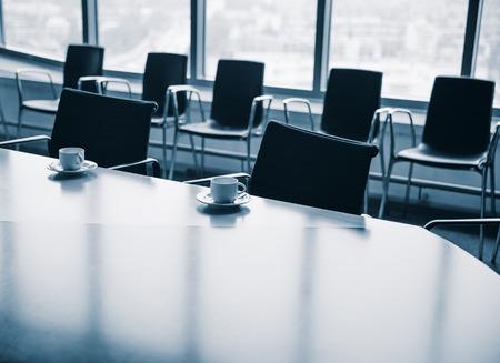 career job: Meeting room with coffee cups before meeting