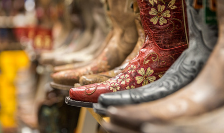 Close-up of new cowboy boots on shelf in a store
