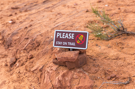 trail sign: Please stay on trail Sign Warning that Hikers should stay on The Trail for Their Protection Stock Photo