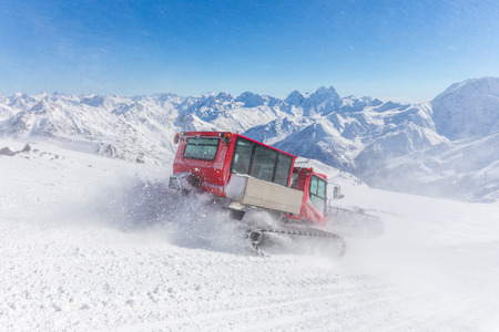 snowcat: Snowcat on a slope high up in the mountains Stock Photo
