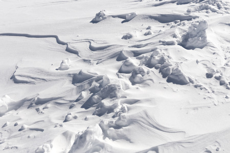 unevenness: Fragment of fresh snow surface texture on sunny day