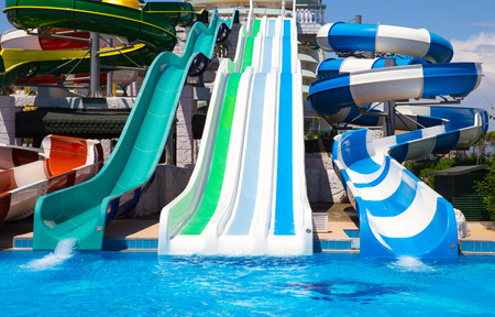 ANTALIA, TURKEY - MAY 11, 2014:  Colorful waterpark tubes and a swimming pool in Delphin Imperial hotel on MAY 11, 2014 in Antalia.