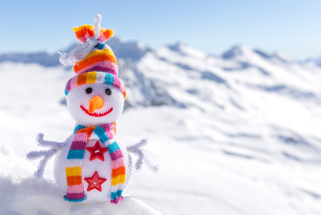snowman: Happy snowman in mountains