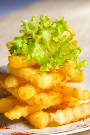 Fresh fried wavy french fries tower