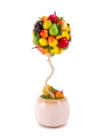 Fruit tree made of artificial fruits in pot Stock Photo