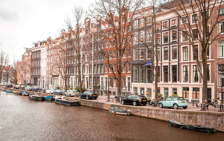 amstel river: AMSTERDAM, NETHERLANDS - MARCH 15: Streets of the city with canals, on March 15, 2014 in Amsterdam