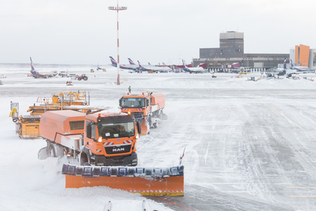 MOSCOW, RUSSIA - DECEMBER 06, 2016 : Snowplow removing snow from runways and roads in airport during snow storm in SHEREMETYEVO airport on December 06.2016 in Moscow. Editorial