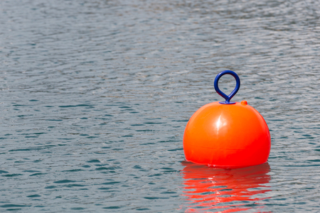 Red Buoy for safety swimming in water Foto de archivo - 107723923